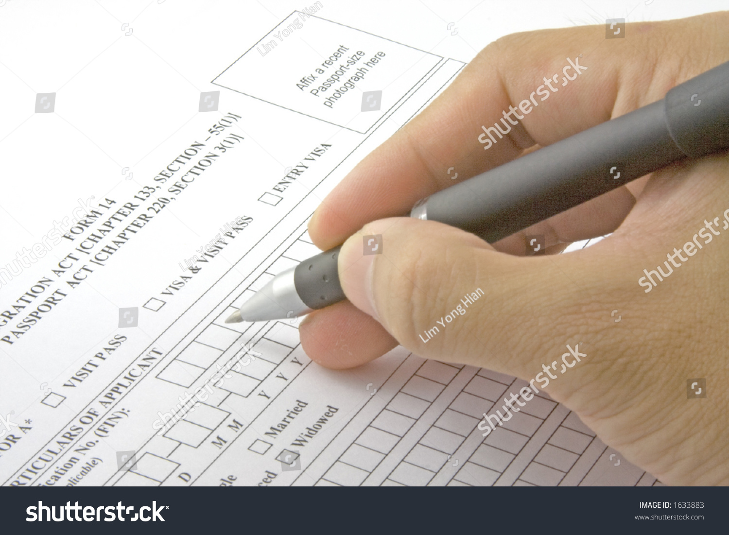 filling in an application form for visa entry stock photo  save to a lightbox