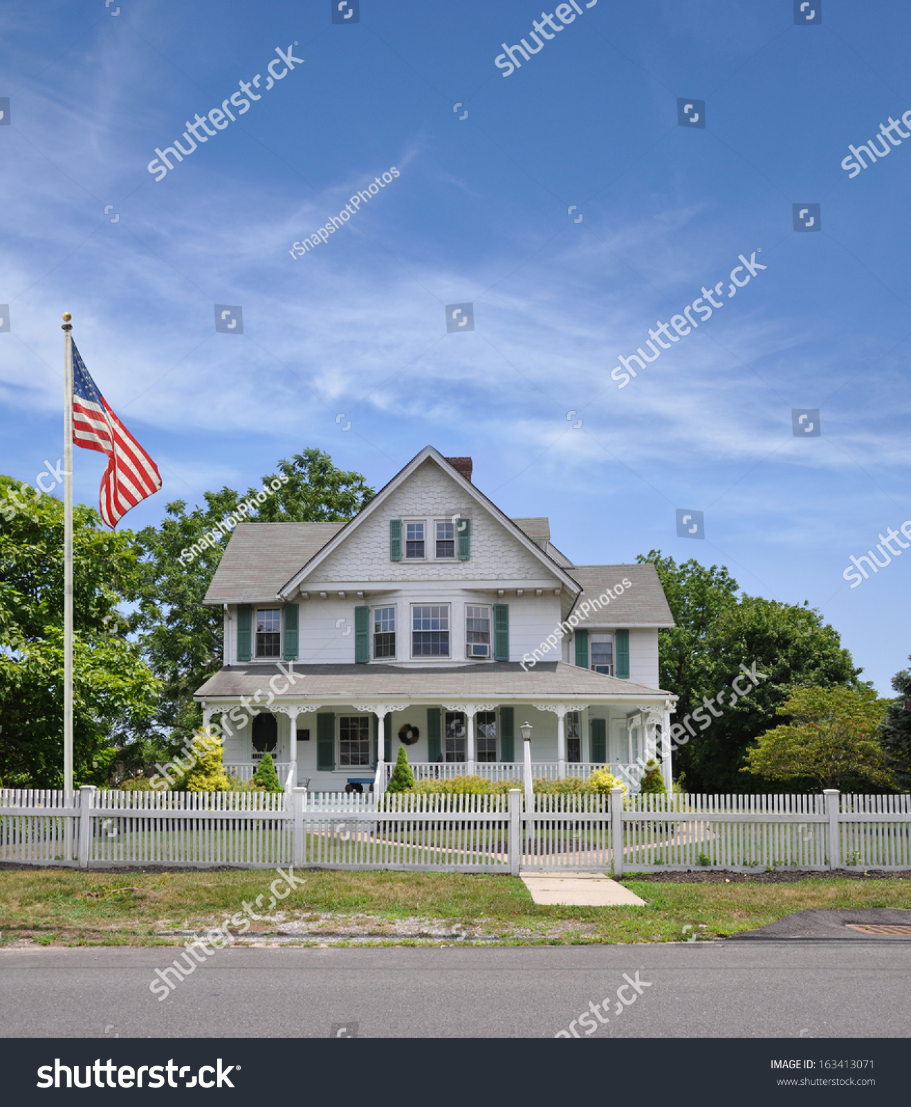 american flag pole large suburban home stock photo