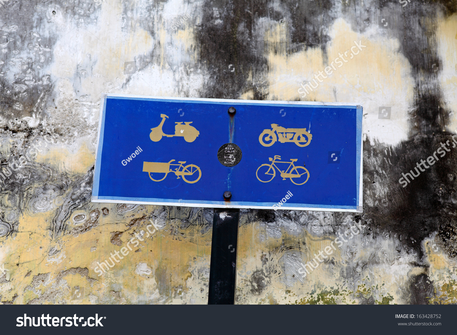 Royalty Free A Metal Road Sign With Symbols Of A 163428752 Stock