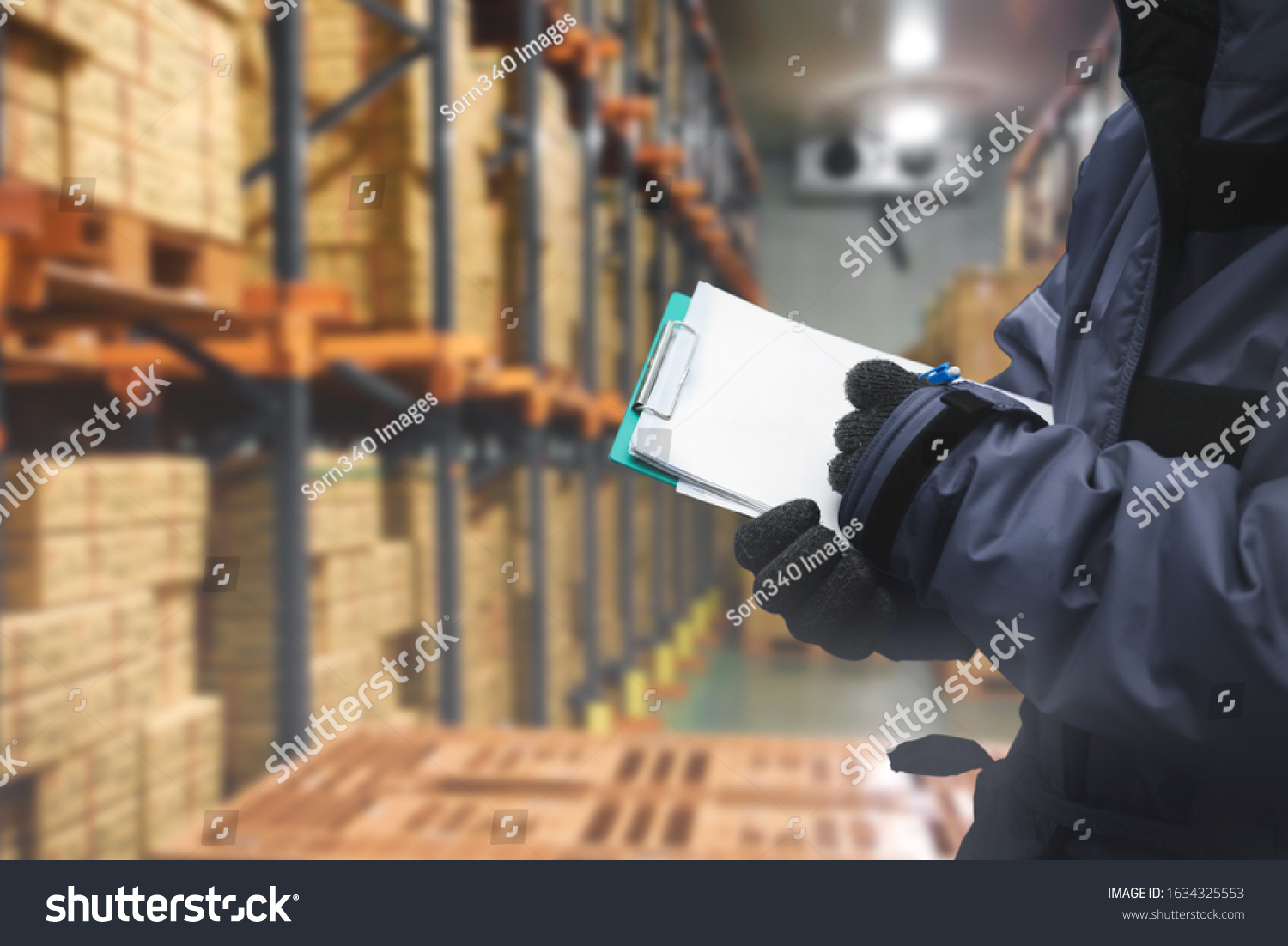QC. worker checking goods on delivery in the cold room warehouse., Logistics food and beverage in cold storage concept #1634325553
