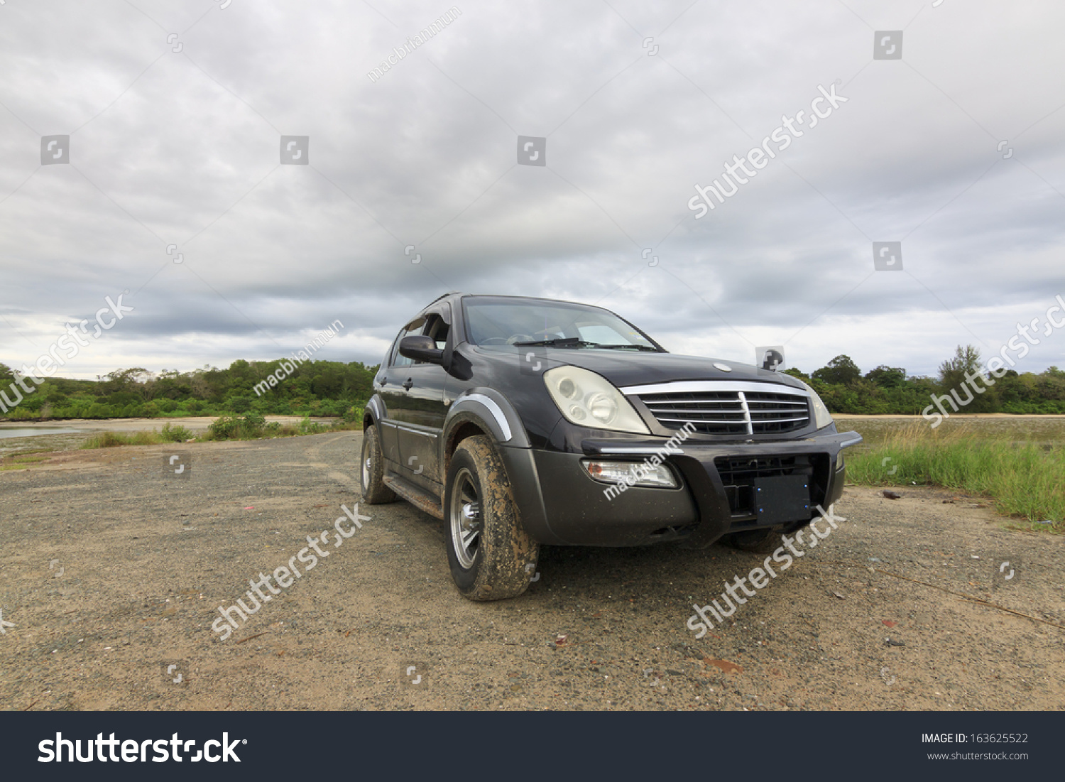 SUV car with gloomy sky #163625522