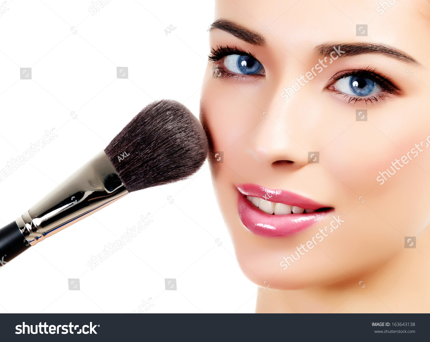 Pretty woman with a cosmetic brush, white background  #163643138