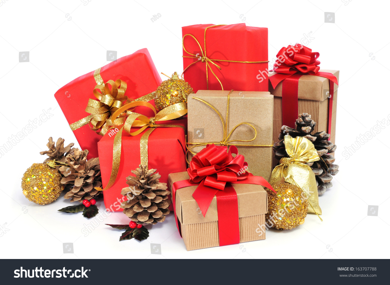 some christmas gifts wrapped with wrapping paper of different colors ...
