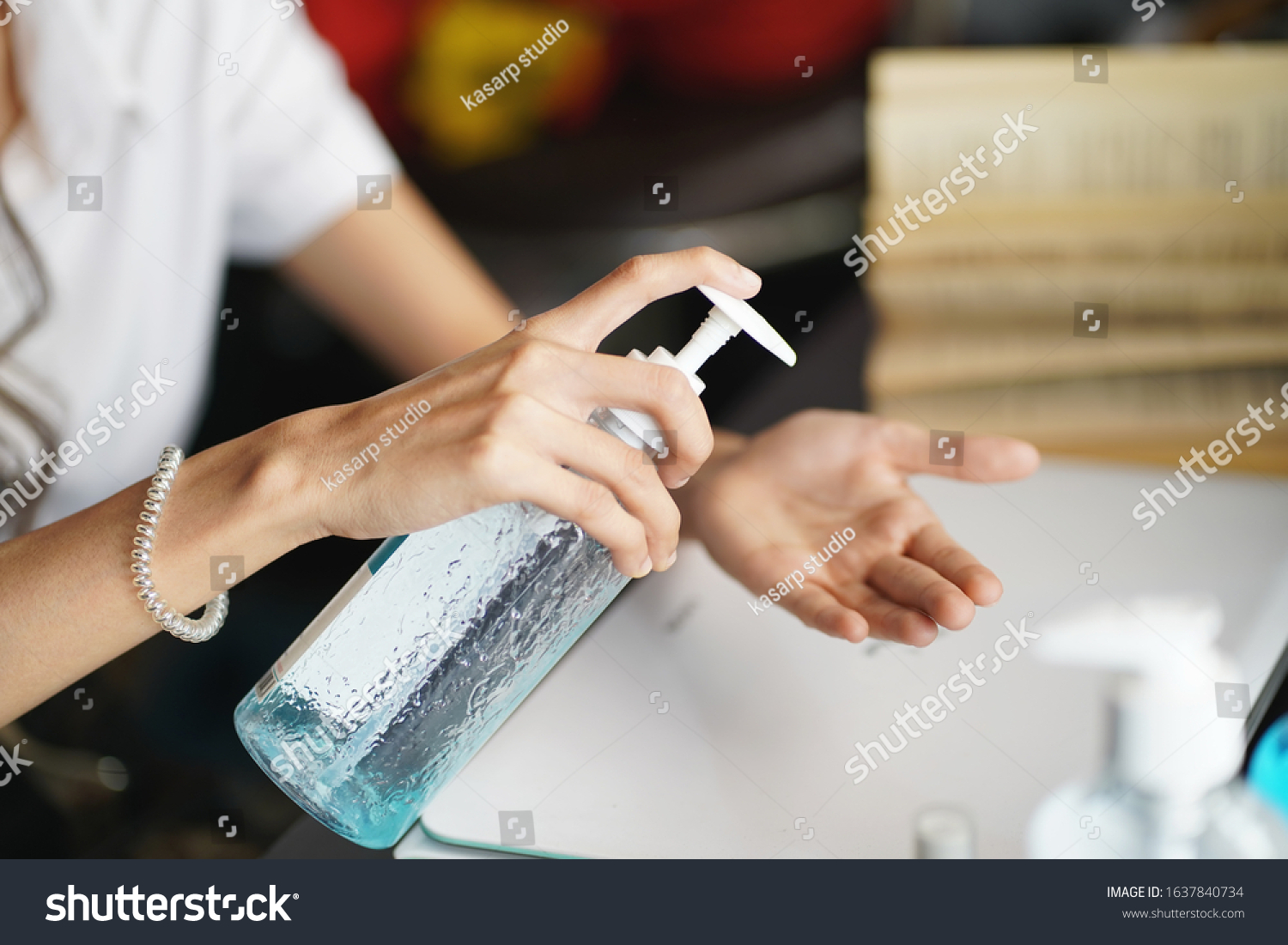women washing hands with alcohol gel or antibacterial soap sanitizer after using a public restroom.Hygiene concept. prevent the spread of germs and bacteria and avoid infections corona virus           #1637840734