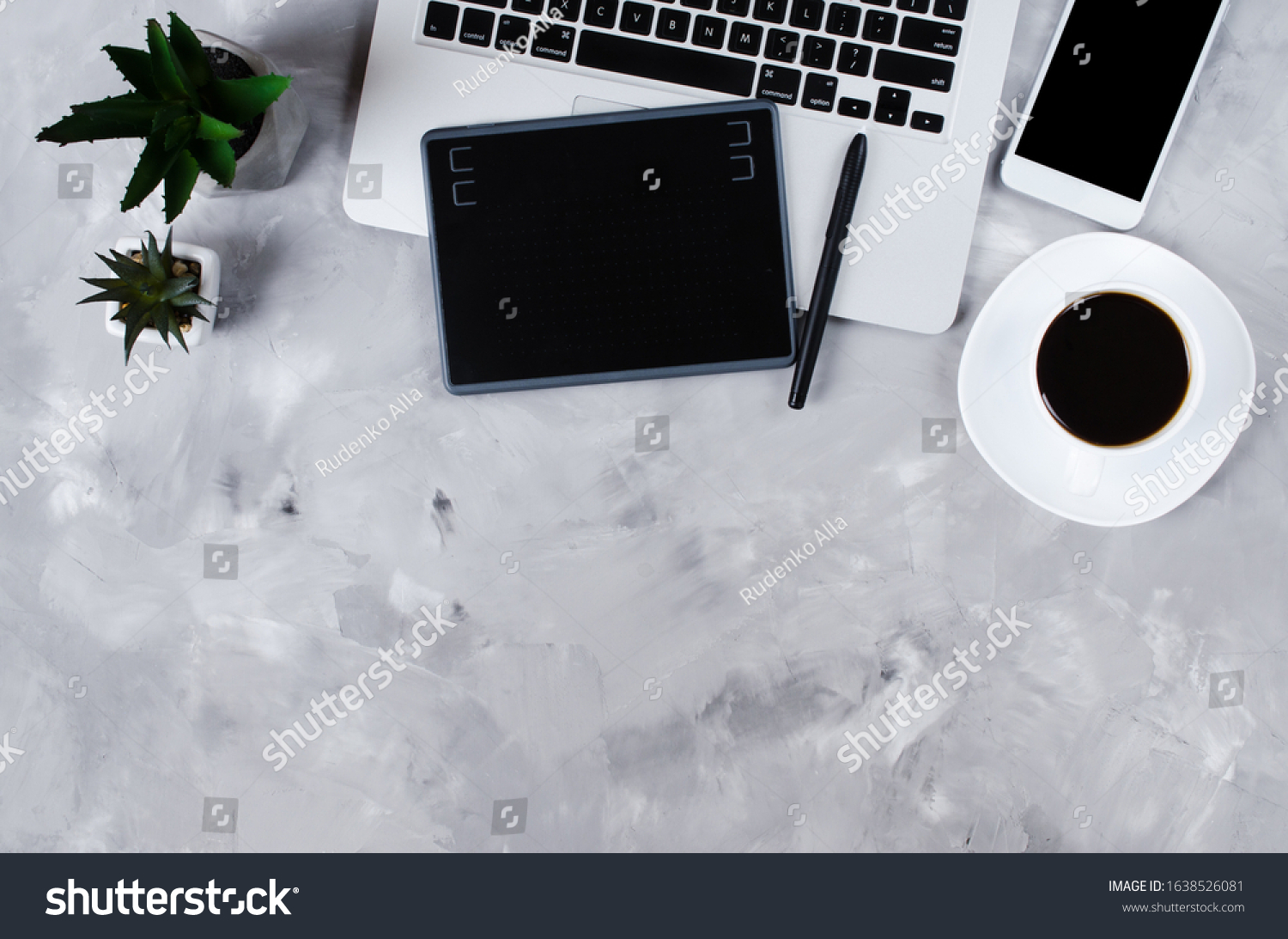 Workspace desk of creative designer, freelancer or photographer. Overhead view of graphic tablet, graphic pen, smartphone, laptop and a cup of black coffee. Flat lay #1638526081