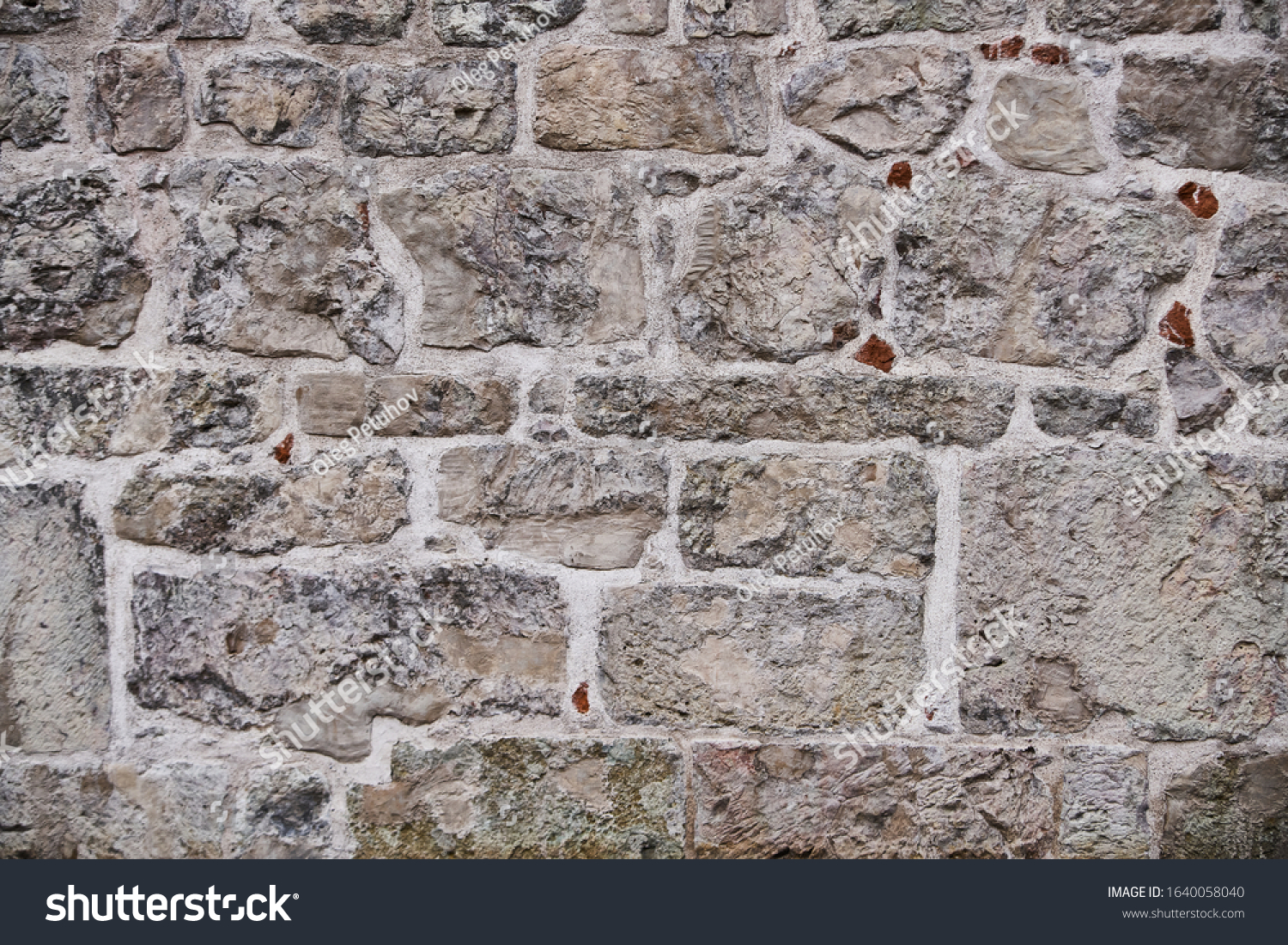 Texture of a stone wall. Old castle stone wall texture background. Stone wall as a background or texture. Part of a stone wall, for background or texture #1640058040