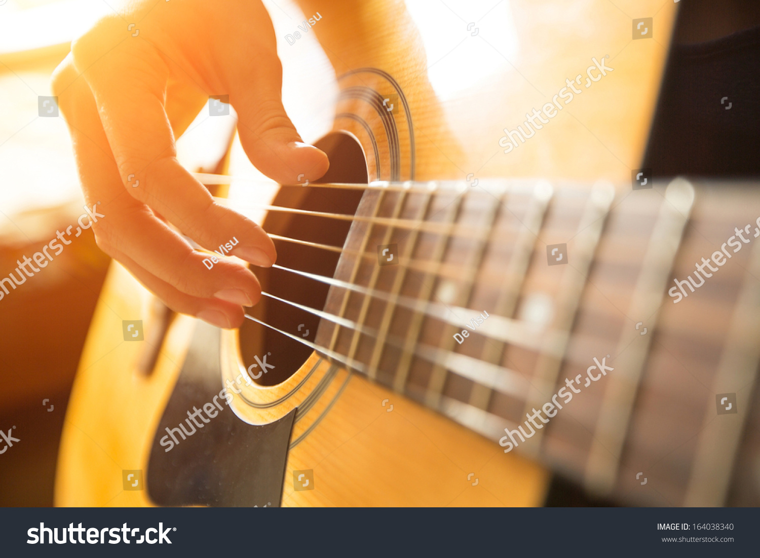 Female Hand Playing On Acoustic Guitar Stock Photo ...