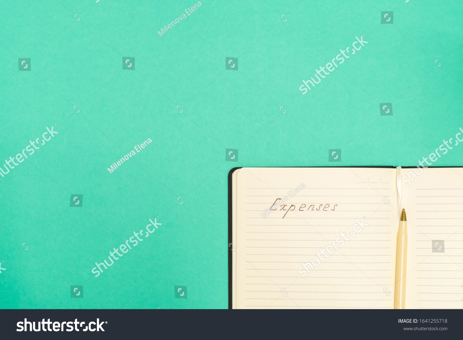 Expense calculation concept. Top view of pen and notepad with handwritten words Expenses on green background with copy space #1641255718