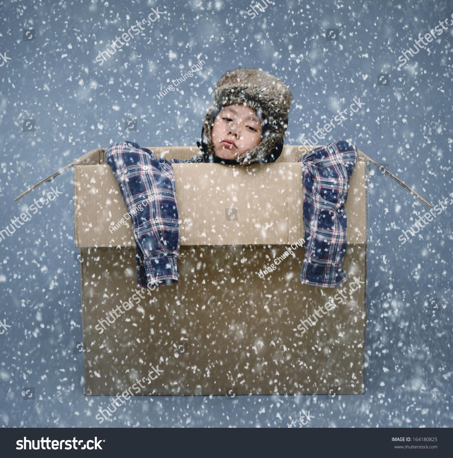 Homeless Boy Gets Bedroom For Christmas: Homeless Boy In Cardboard Box During Winter Snowfall Stock