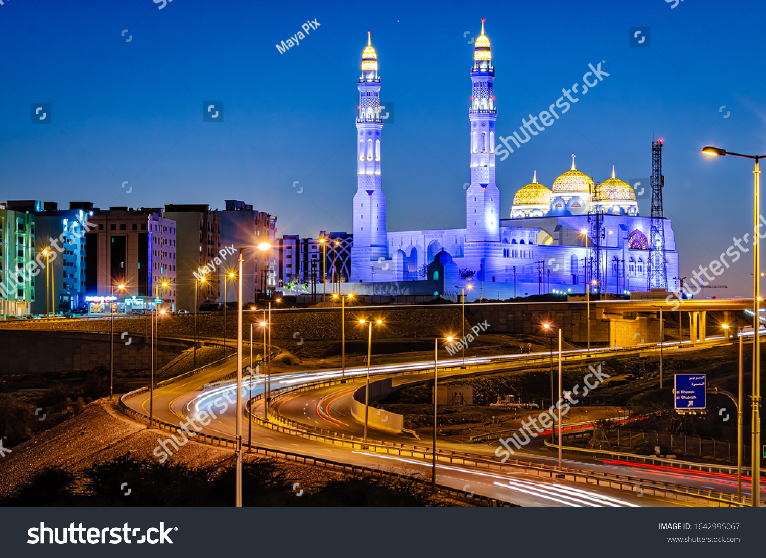 Muscat/Oman - Jan 17, 2020: Motion Trails in front of the beautifully lit  Mohamed Al Ameen Mosque in Muscat, Oman in the evening.