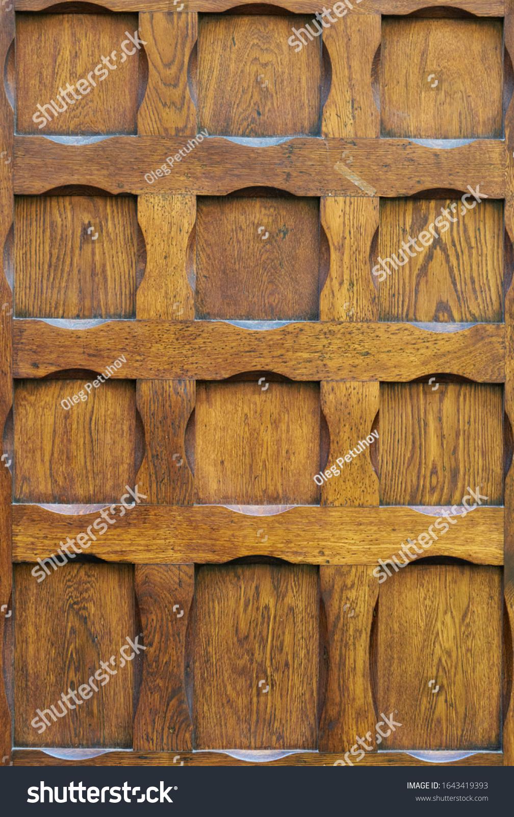 Old oiled wood door texture. #1643419393