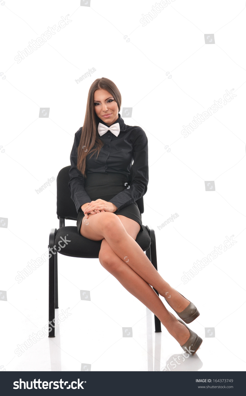 Young Beautiful Woman Siting On A Chair With Her Legs