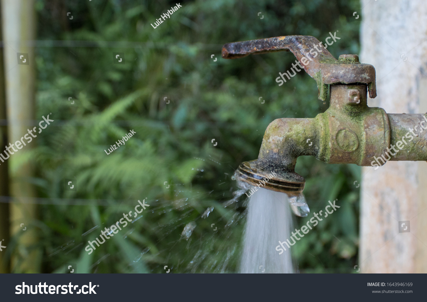 stock-photo-water-running-from-an-old-ru