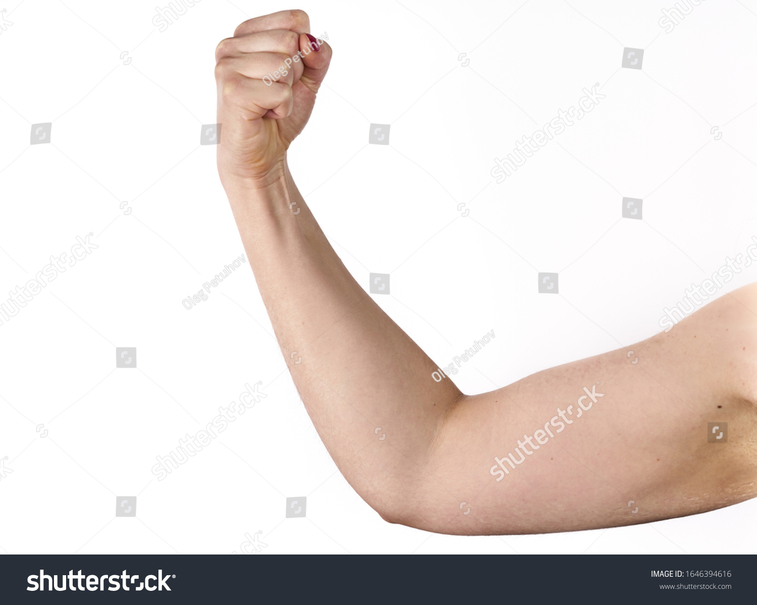 closeup picture of sporty woman flexing her biceps. #1646394616