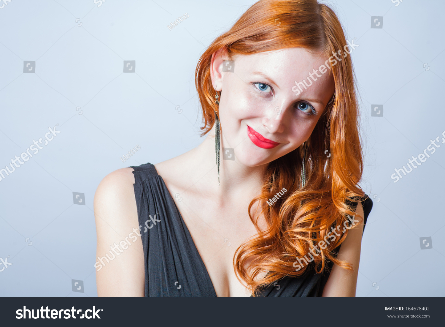head and shoulders shot of the foxy-red women