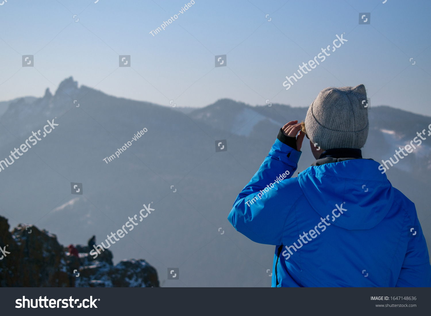 stock-photo-woman-in-the-mountains-in-wi