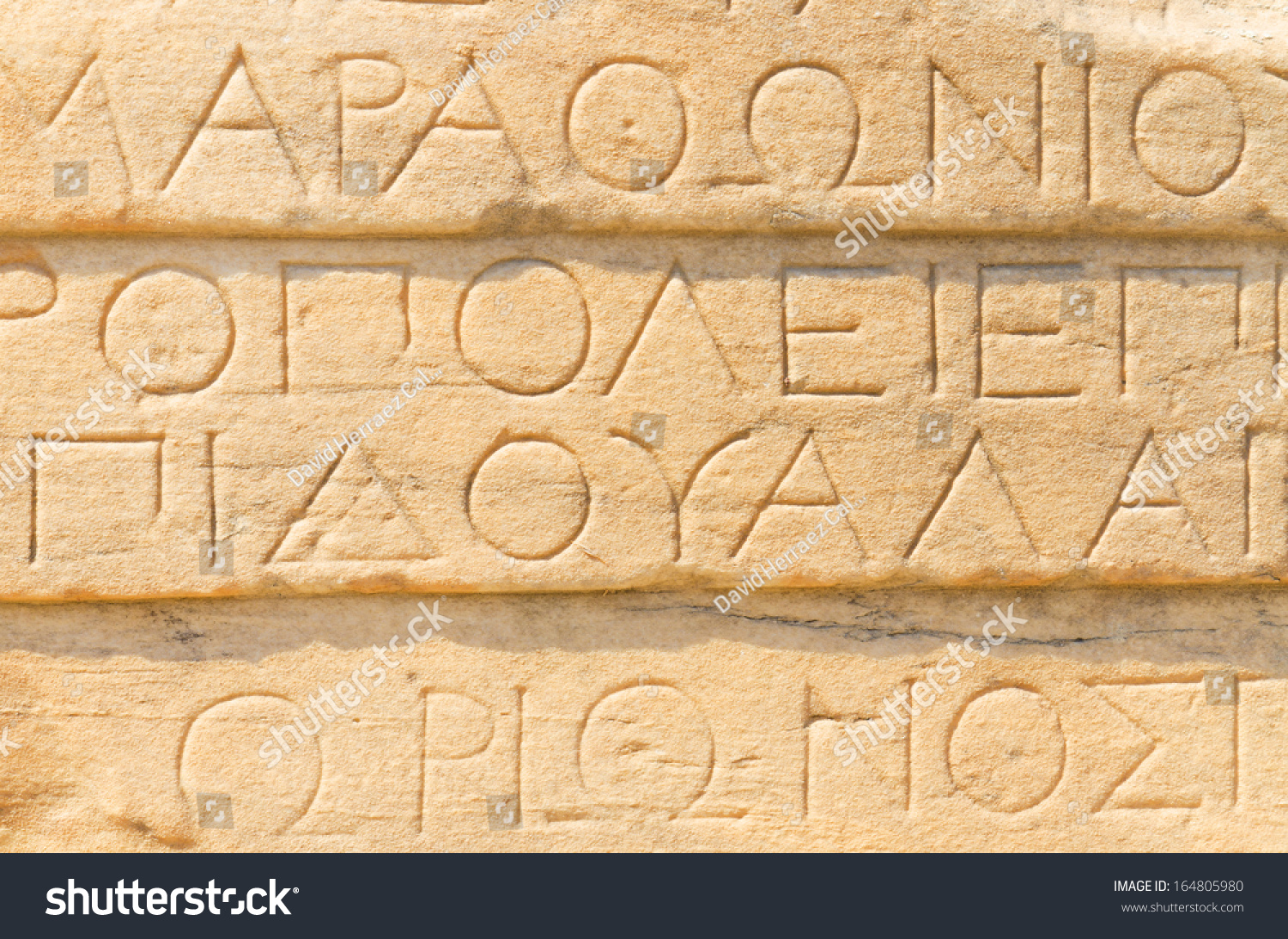 Ancient Greek Writing On Stone Stock Photo 164805980