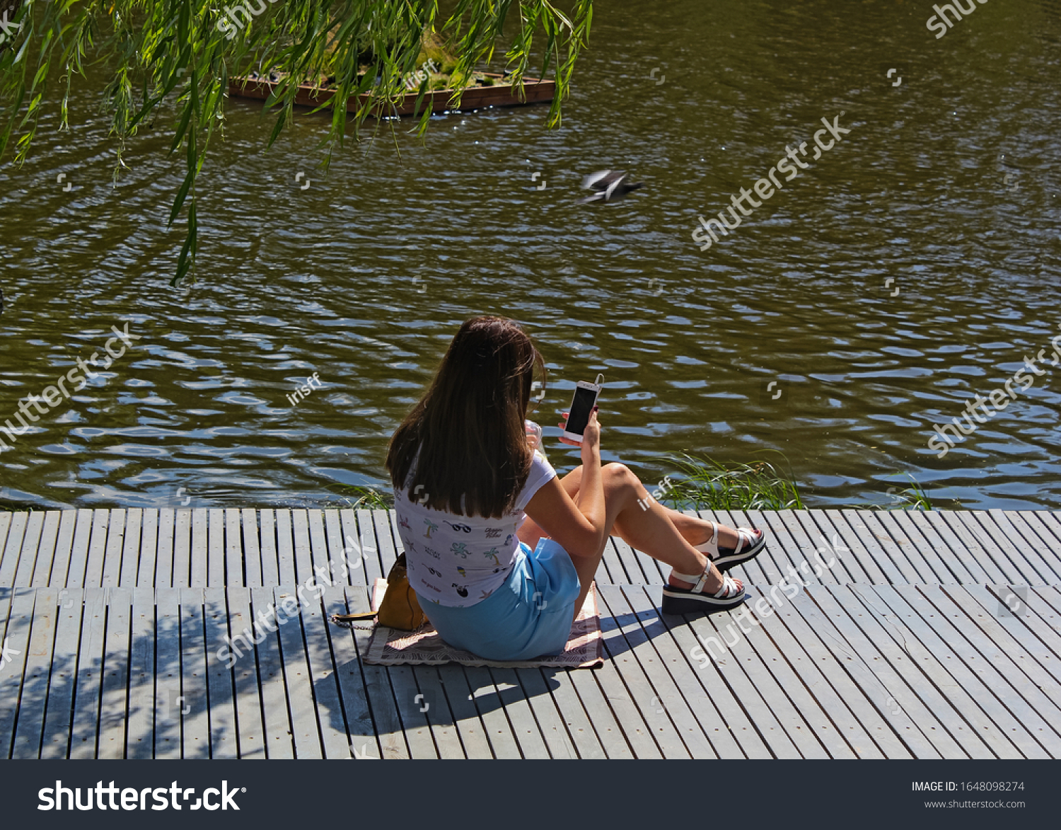 stock-photo-a-girl-in-summer-clothes-sit