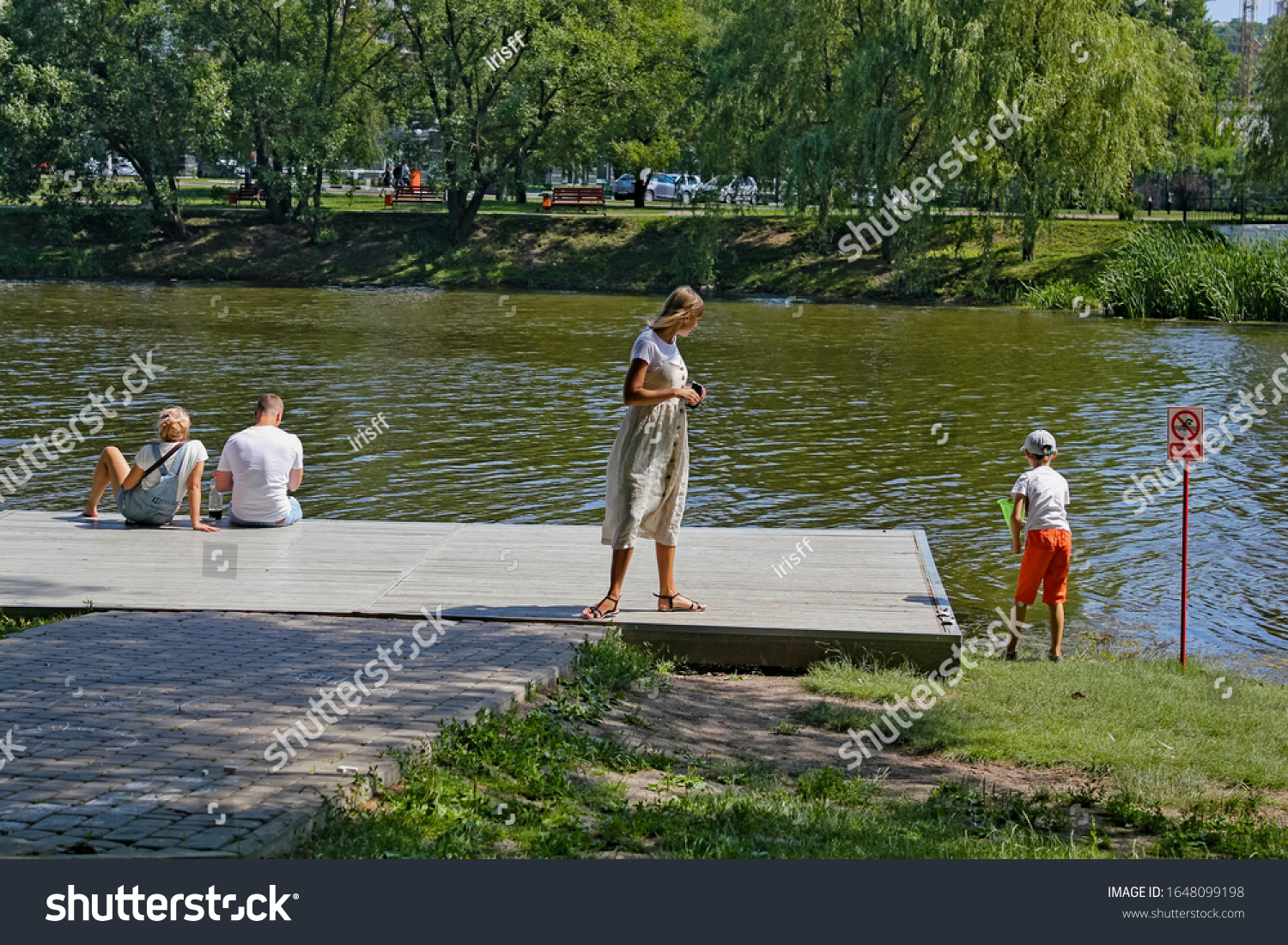 stock-photo-people-on-a-wooden-bridge-by