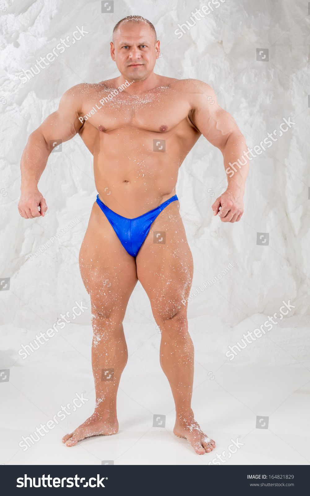 Royalty Free Male Bodybuilder In Trunks With Snow On 164821829