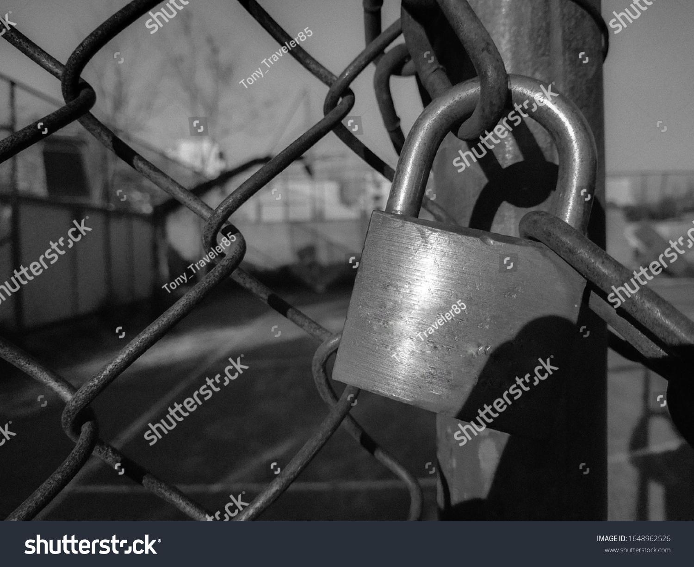 stock-photo-basketball-court-gate-s-lock