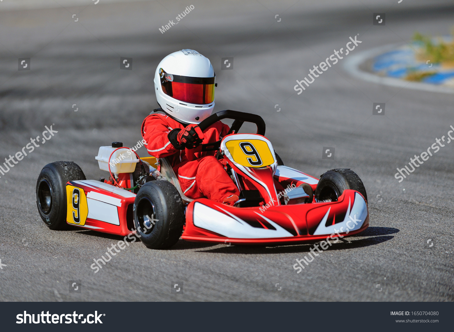Young go cart racer on circuit #1650704080