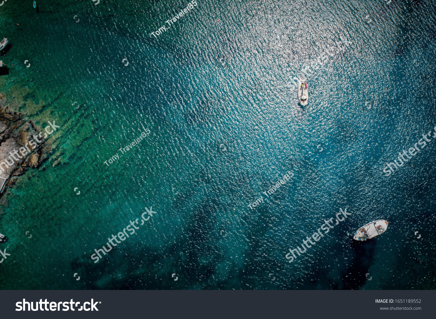Aerial view of traditional Greek mediterranean fishing boats in the coast of Peloponisos, Greece