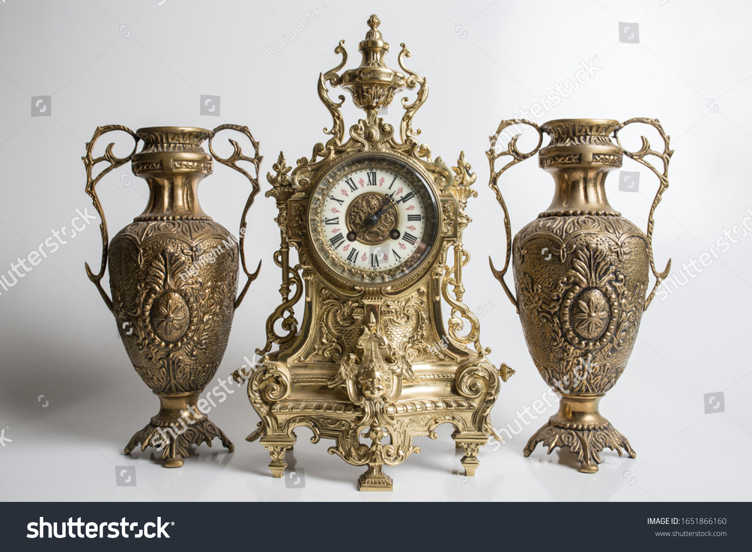 bronze amphorae and clock on a white background, antique vases and clock studio photo, antique clock and two antique vessels,  #1651866160