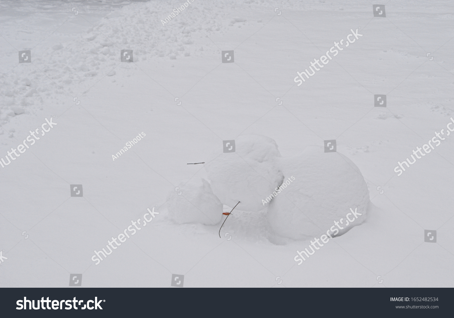 stock-photo-end-of-winter-a-broken-snowm