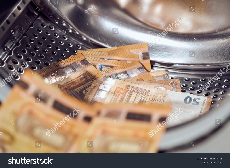 Money in washing machine, closeup view. Money washing. Money laundering #1652531125