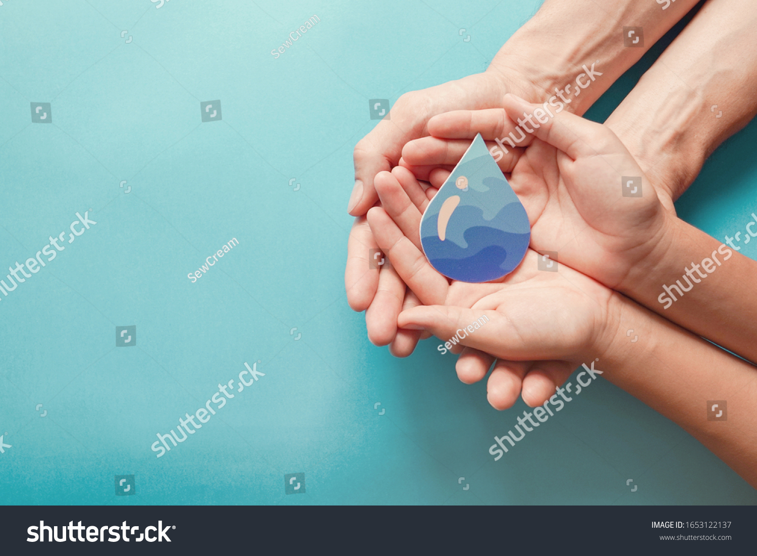 Hands holding clean water drop,world water day,hand sanitizer and hygiene, vaccine for covid-19 pandemic, family washing hands, CSR, save water, clean renewable energy, flood disaster relief concept  #1653122137