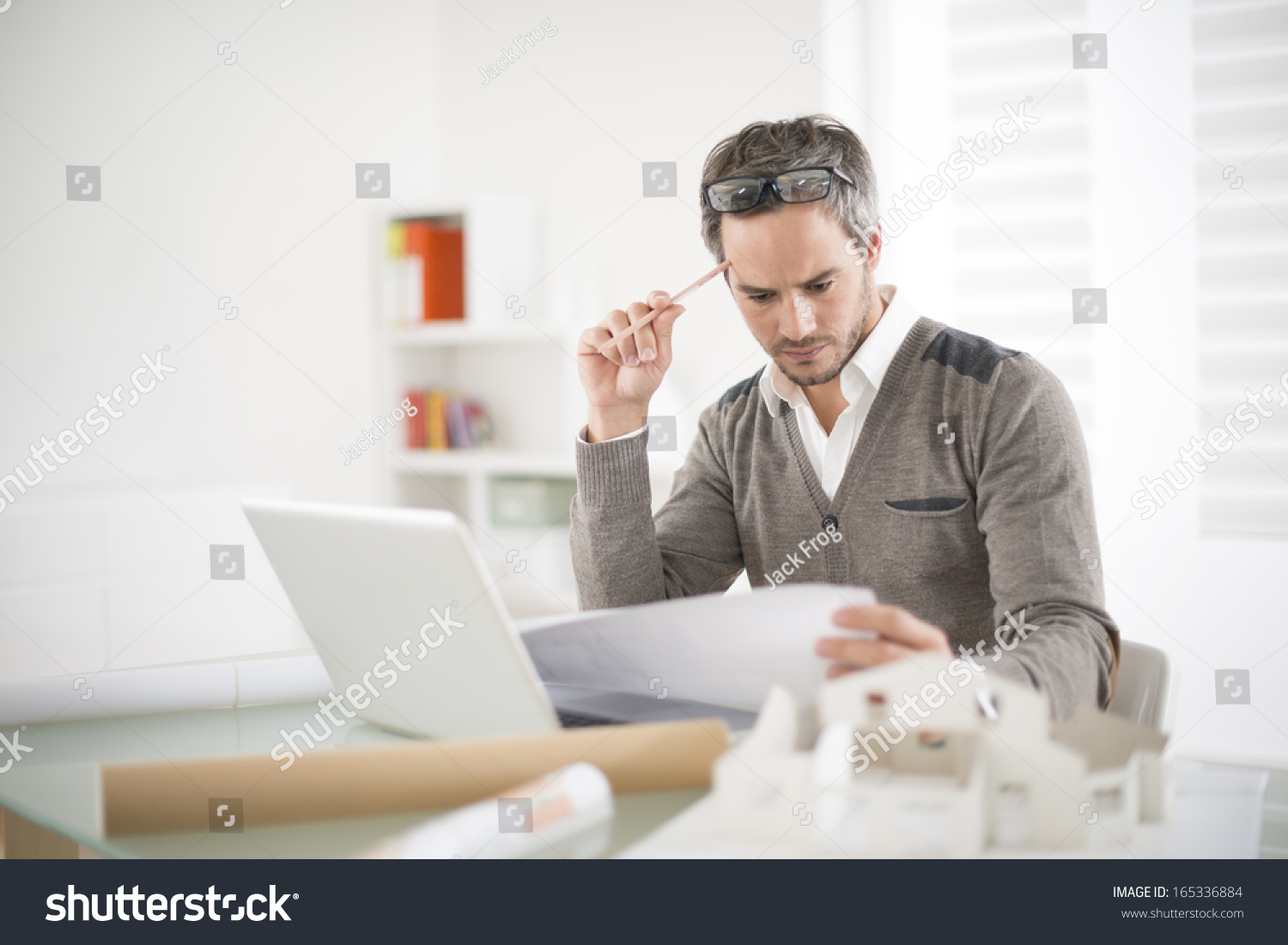 architect working his laptop on office stock photo 165336884