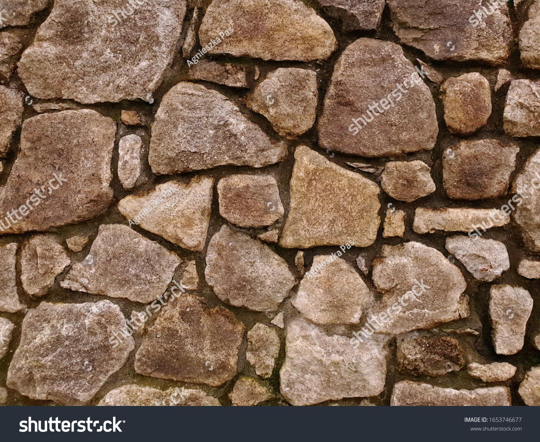 stock-photo-natural-stone-wall-backgroun