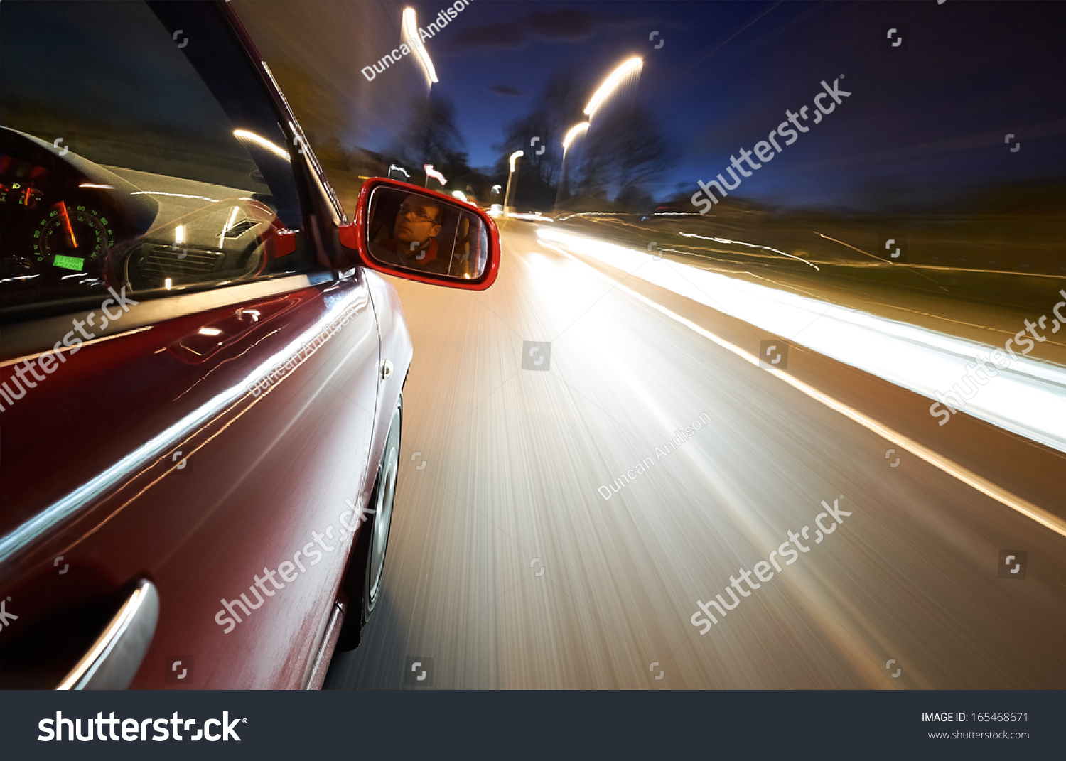 man driving car night on straight stock photo 165468671