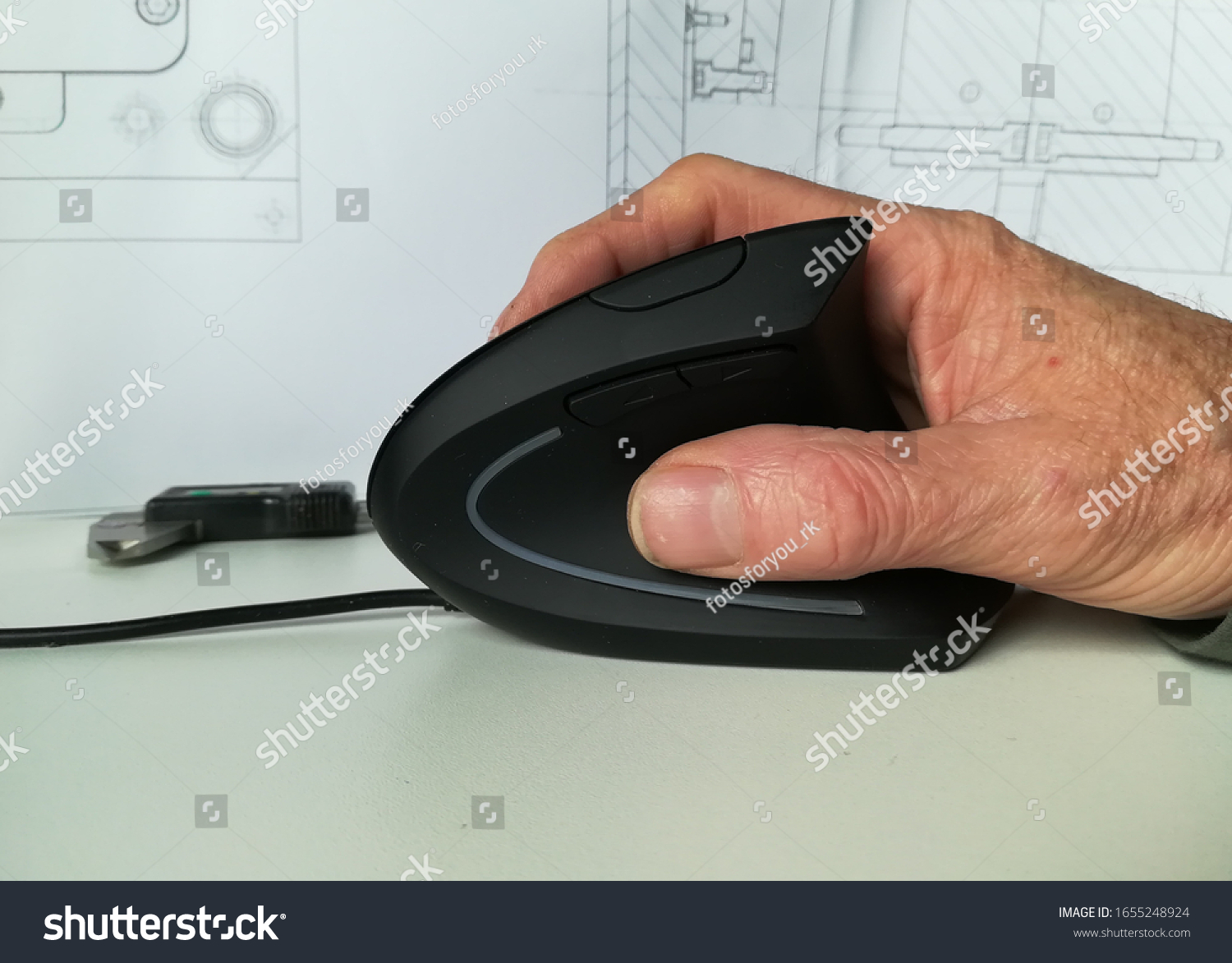 Male hand holding computer mouse with copy space. Construct with a 3d mouse