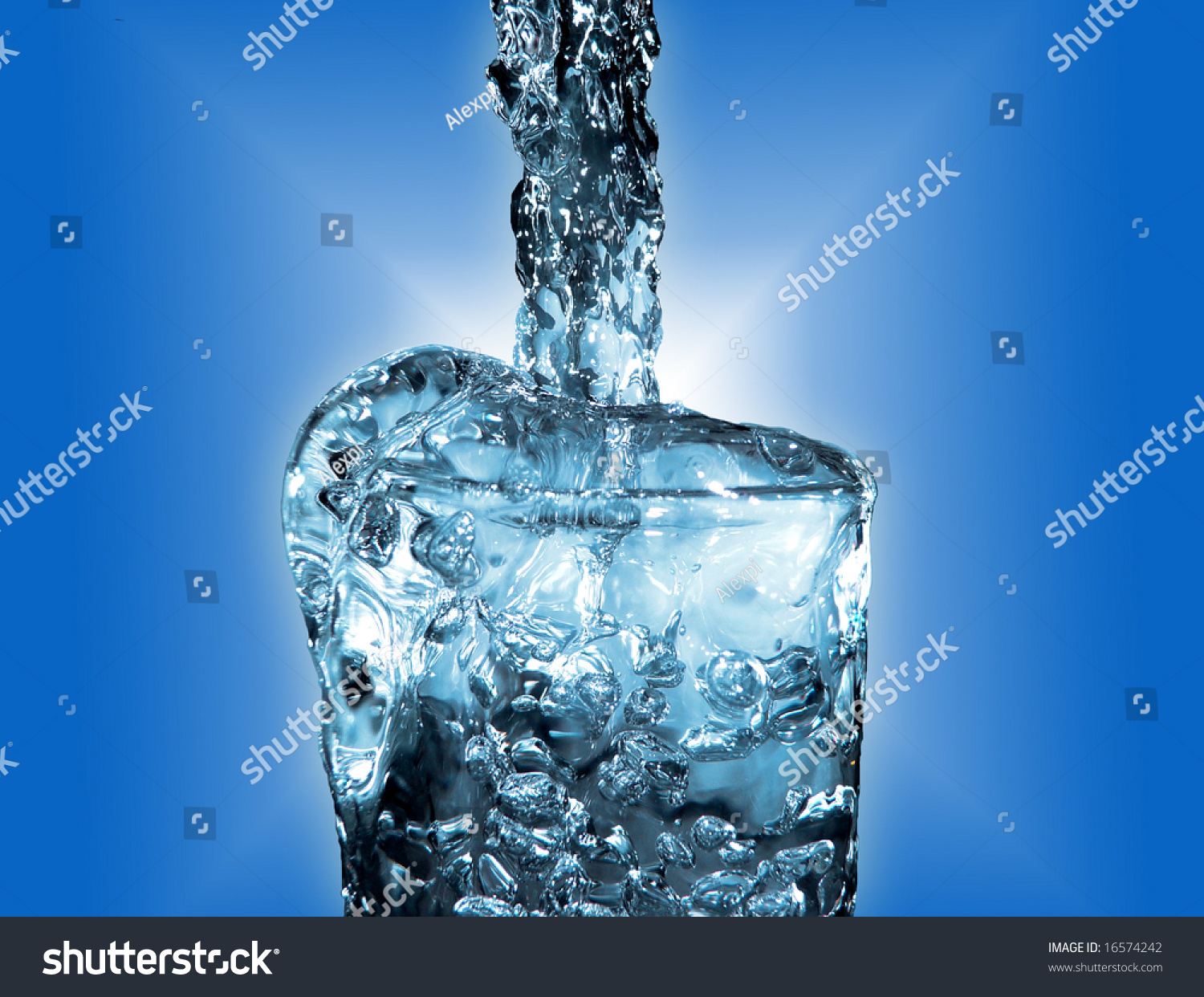Water Stream Overflowing The Glass Stock Photo 16574242 ...