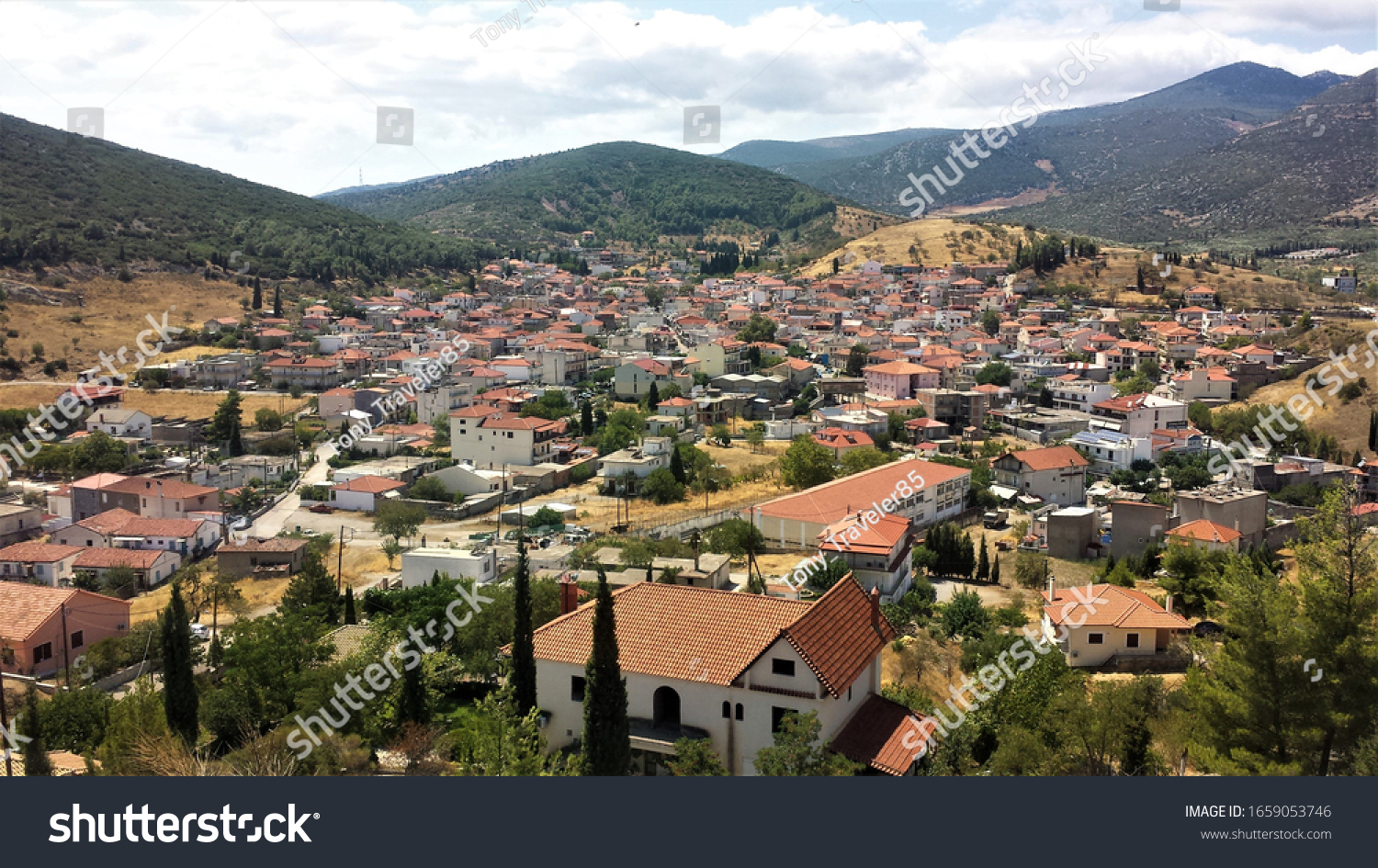 Panoramic view of Distomo in sunny summer day. Distomo is a semi-mountainous town in the southwestern part of Livadia province of Boeotia, Greece