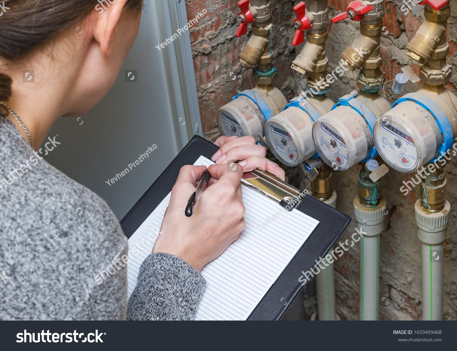 Woman Checking Readout On Water Meter Stock Photo (Edit Now) 1659499468 [ 1152 x 1500 Pixel ]
