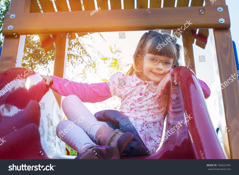 Beautiful girl sunglasses sitting on roller stock photo