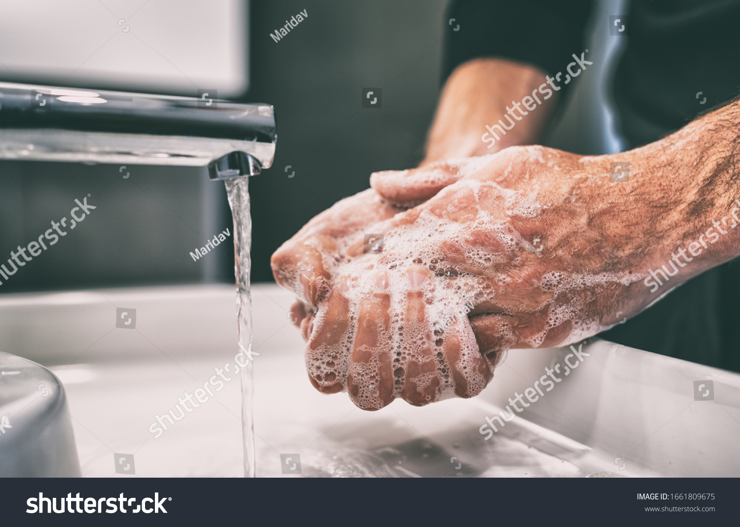 Coronavirus pandemic prevention wash hands with soap warm water and , rubbing nails and fingers washing frequently or using hand sanitizer gel. #1661809675
