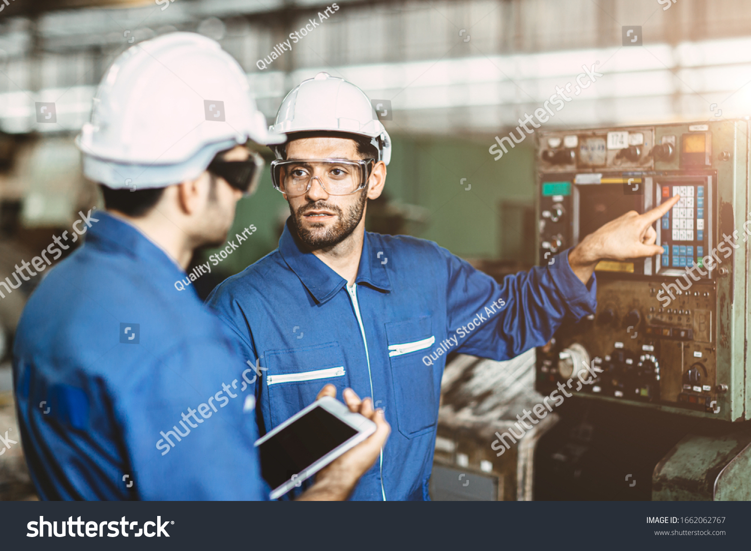 Engineer team talking together to discussion teach and learn give education technical about using machine in factory workplace. #1662062767