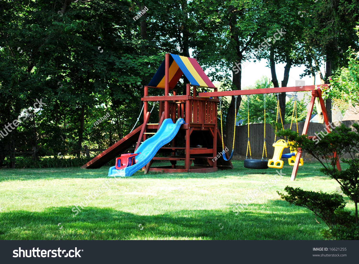 Backyard Jungle Gym Made Wood Slide Stock Photo - Backyard jungle gyms