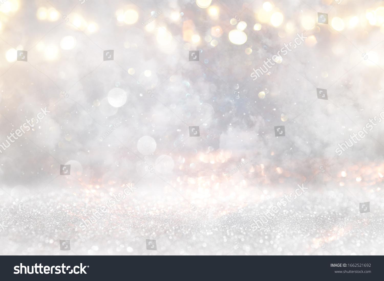 glitter vintage lights background. gold, silver and white. de-focused #1662521692