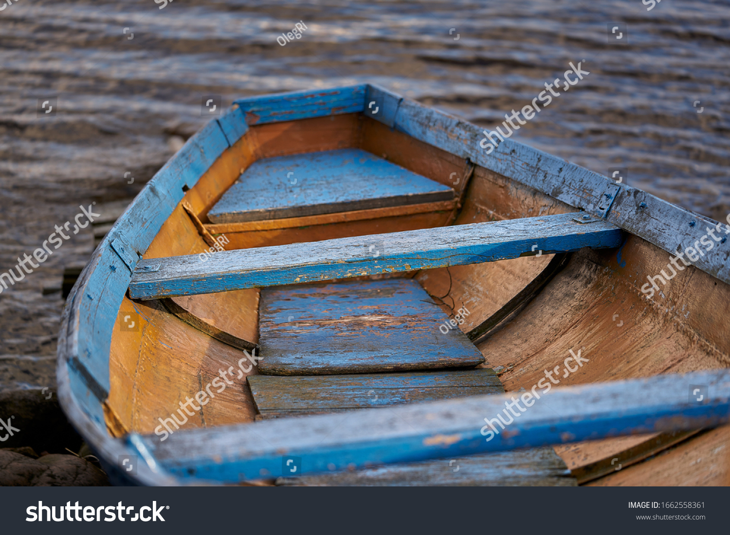 Old boat resting on the beach. #1662558361