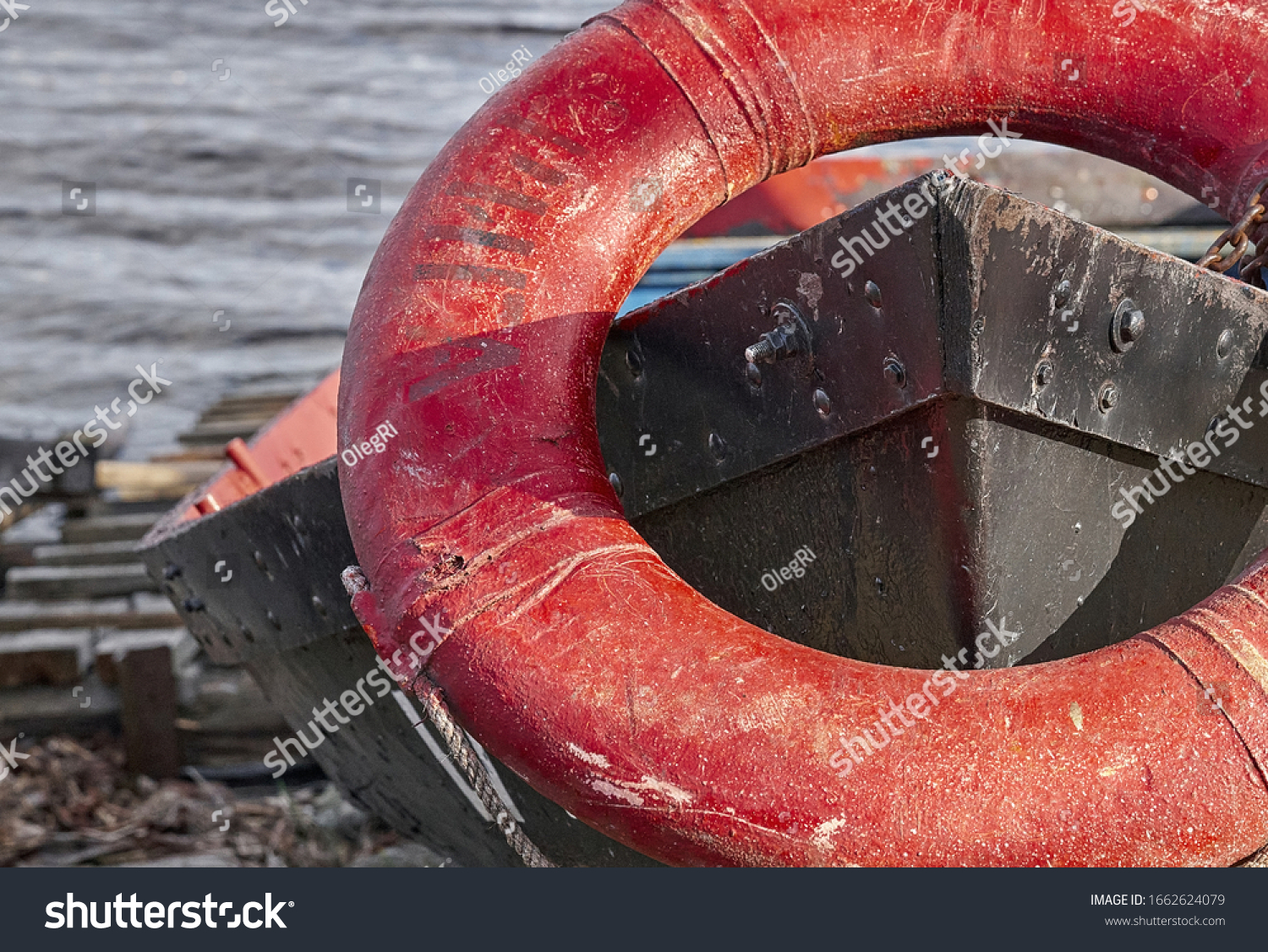 life buoy on the bow of an old boat. #1662624079
