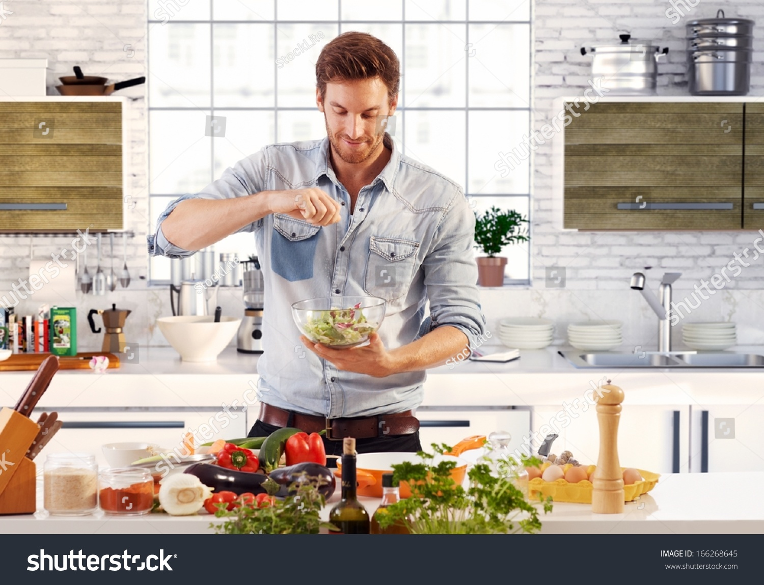Handsome Man Cooking Home Preparing Salad Stock Photo ...