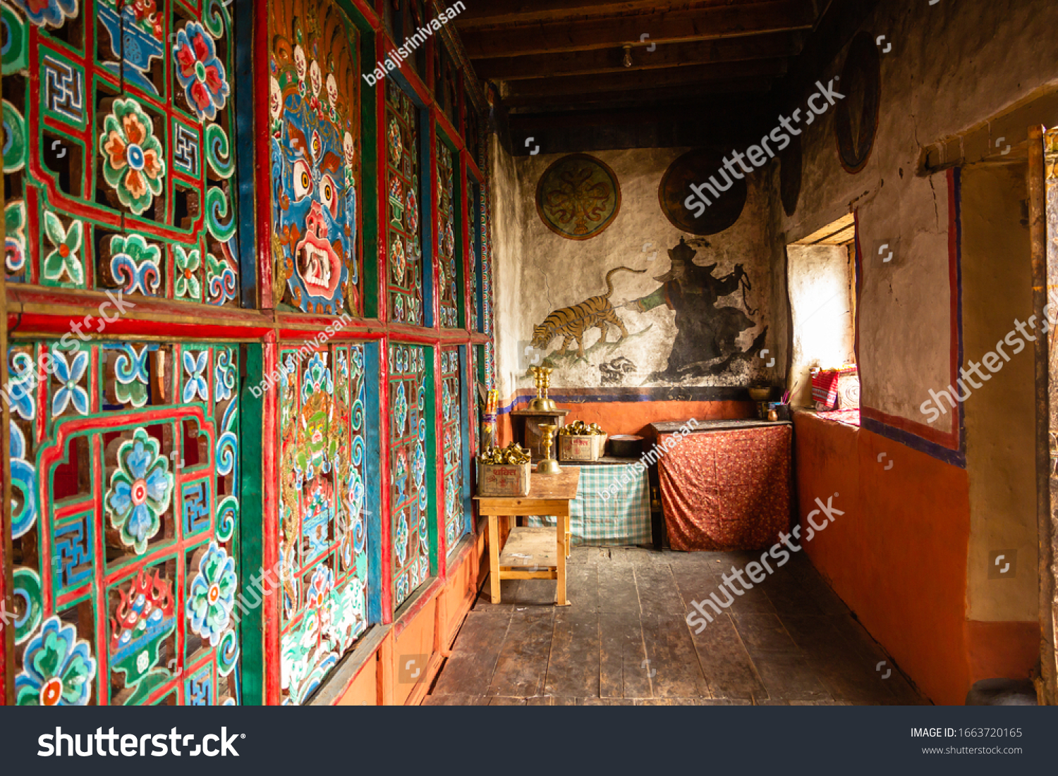 Muktinath, Mustang, Nepal - April 2015: Colorful murals inside the ancient Buddhist monastery at Muktinath in Nepal.