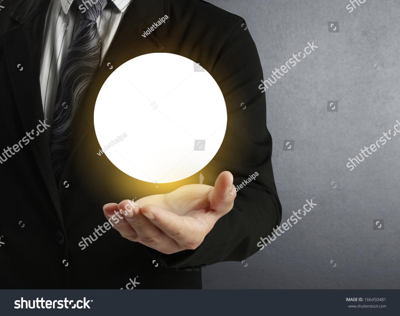 Technology Management Image: Businessman Hand Holding Crystal Ball Stock Photo
