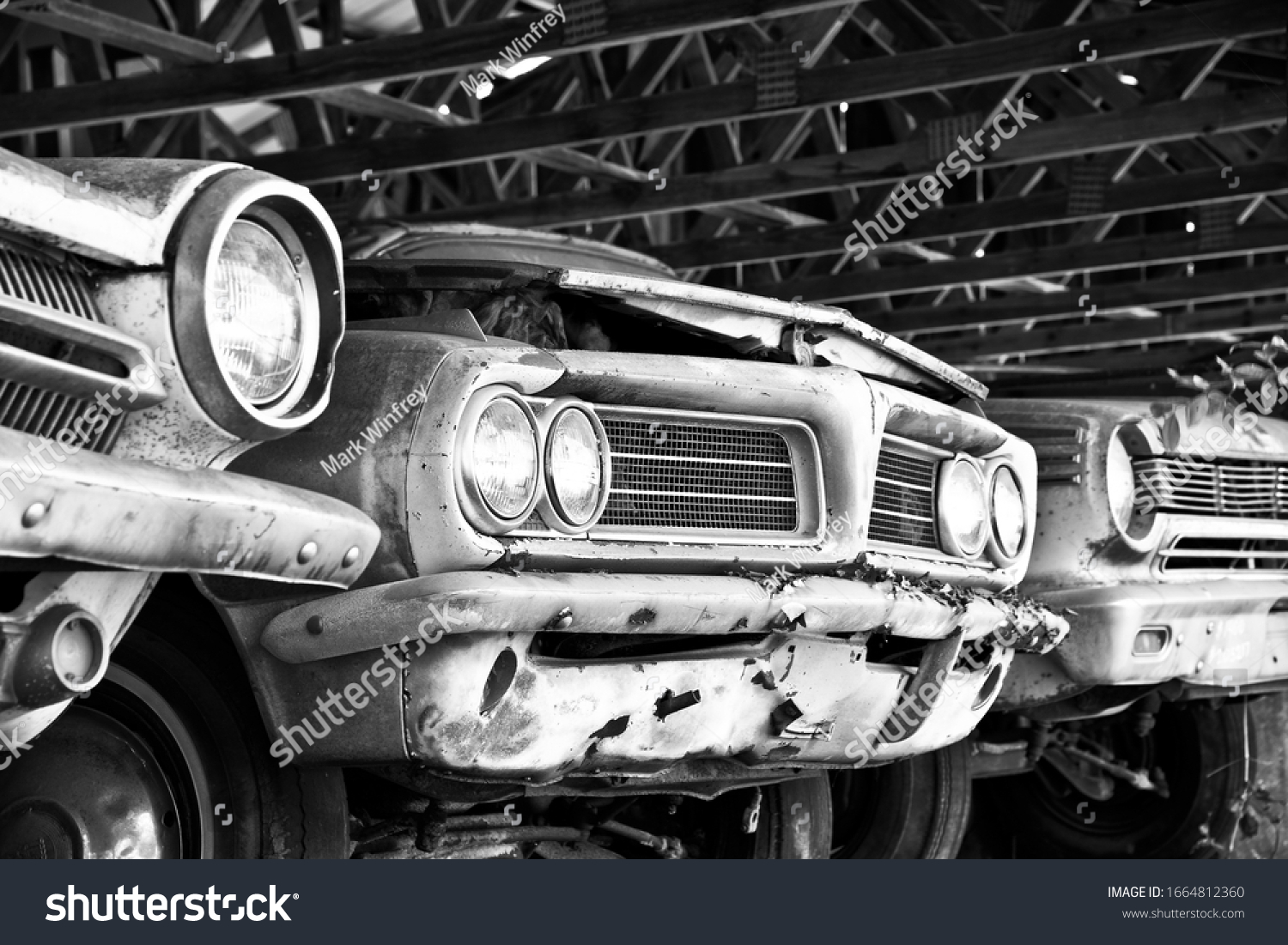 White, GA / USA - October 17, 2018: Close-up Image of the Front of an Old Cars in a Storage Shed at the Junk Yard