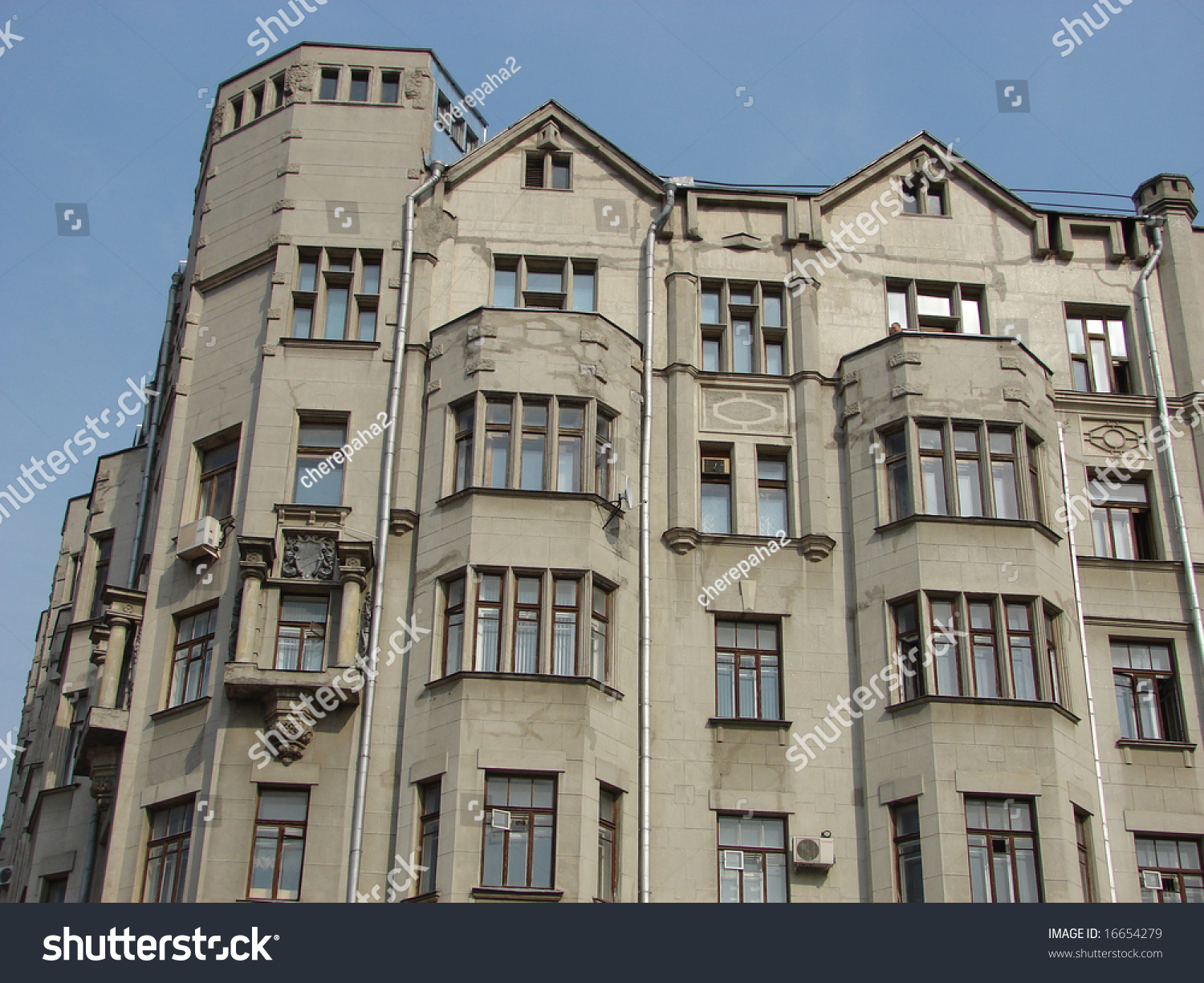 old brick apartment building against a blue sky stock photo 16654279 shutterstock. Black Bedroom Furniture Sets. Home Design Ideas